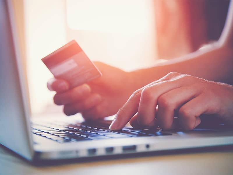 Hands Holding Credit Card And Using Laptop. Online Shopping | ITque